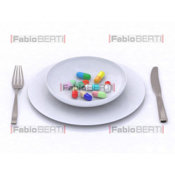 colored pills on a plate