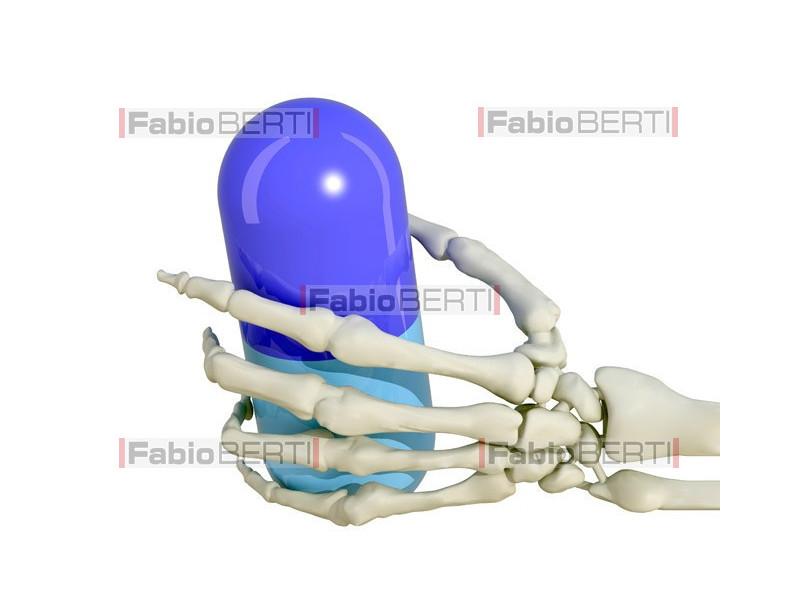mano scheletro con pillola
